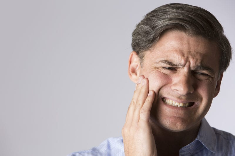 Man suffering with toothache