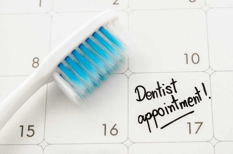 "Reminder ""Dentist appointment"" in calendar with toothbrush."
