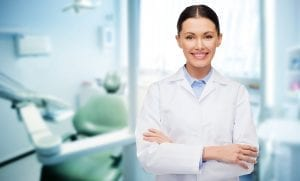Dentist smiling with her arms crossed.