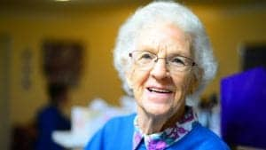 an elderly woman smiling